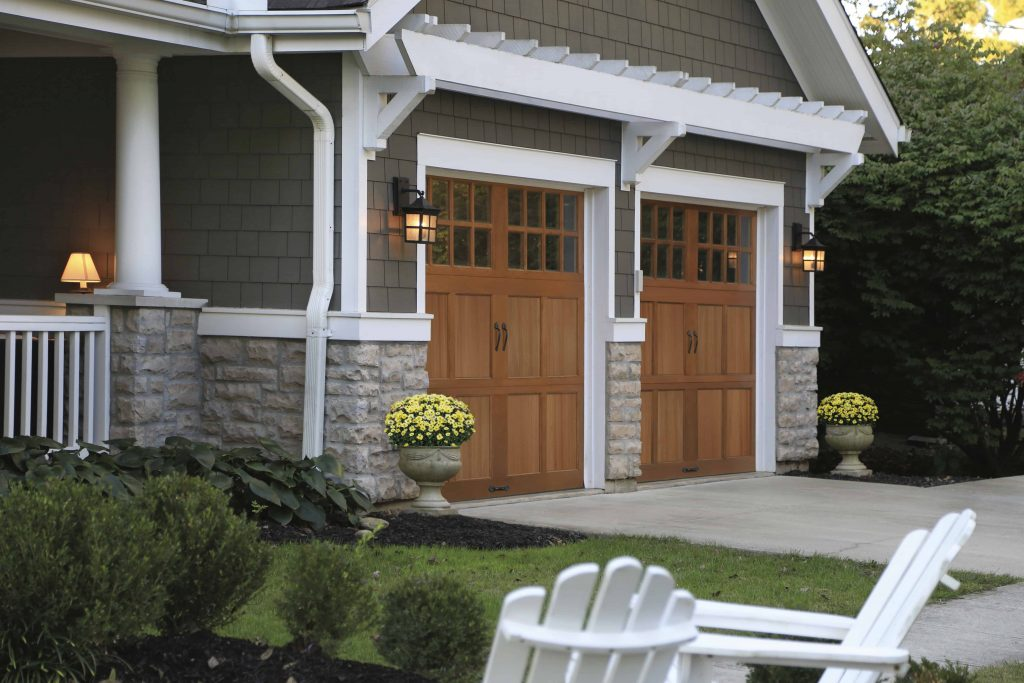 House with wooden garage doors
